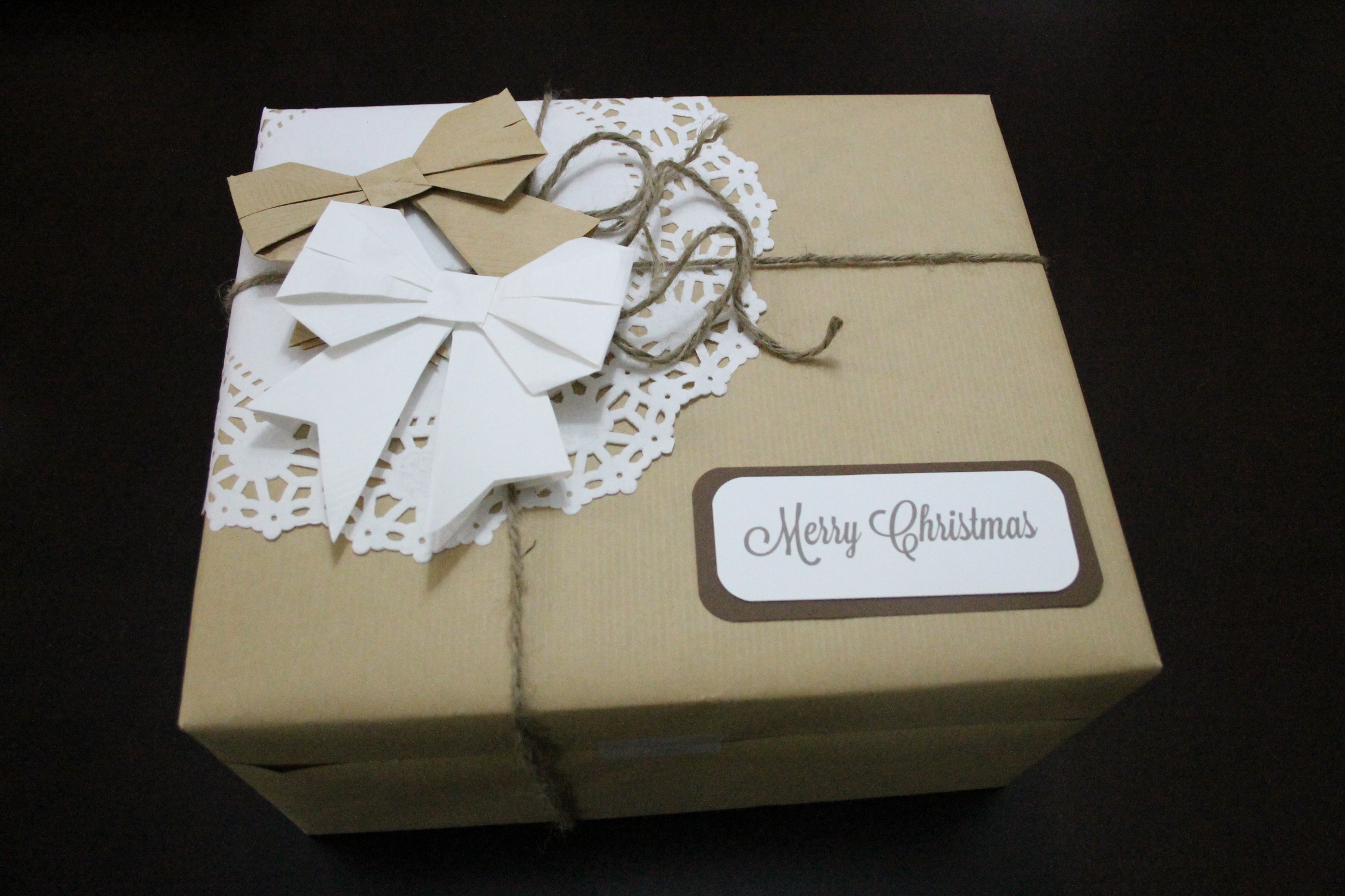 Christmas wrapping paper idea origami bows with doilies